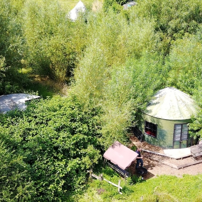 A drones view of a woodland Glamping Site